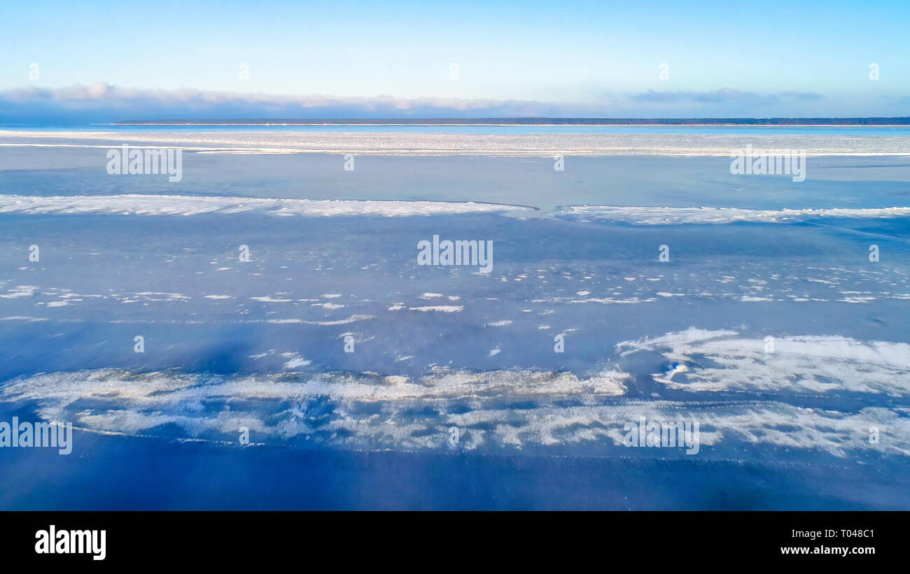 The frozen snow on the ocean in Estonia seen on an aerial shot on a winter season - Stock Image