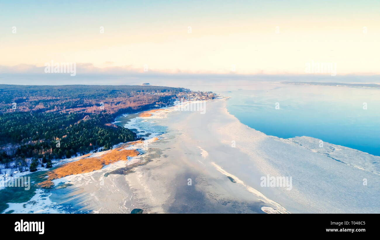 Aerial view of the frozen sea in Kasmu Laheema and the trees on the forest fronting the frozen sea - Stock Image