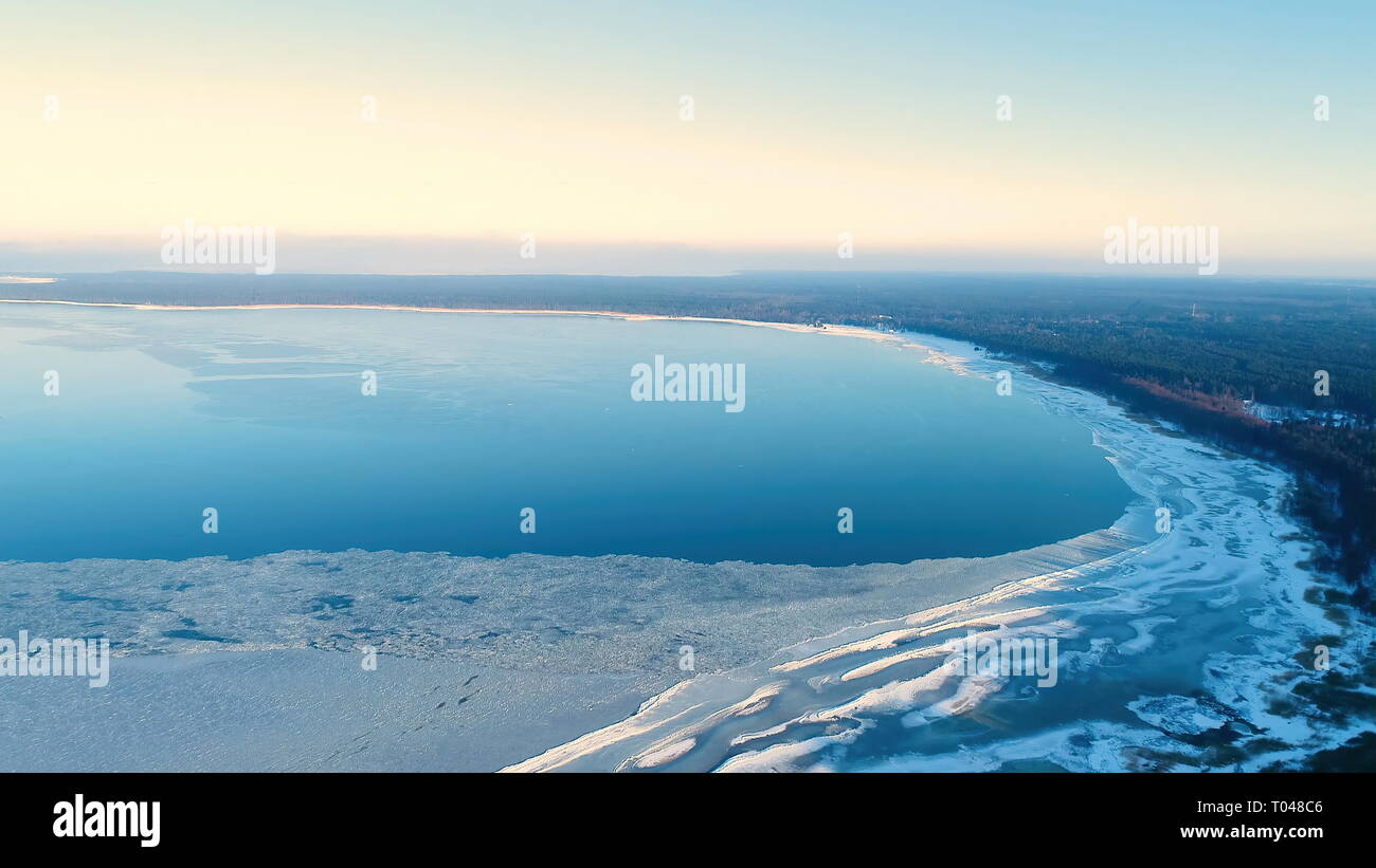Aerial shot of the Laheema park with freezing water on the sea shore and seen the tall trees in the forest - Stock Image