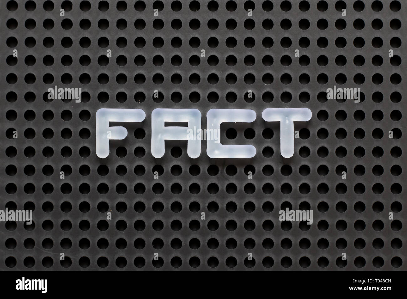 Black color pegboard with white letter in word  fact - Stock Image