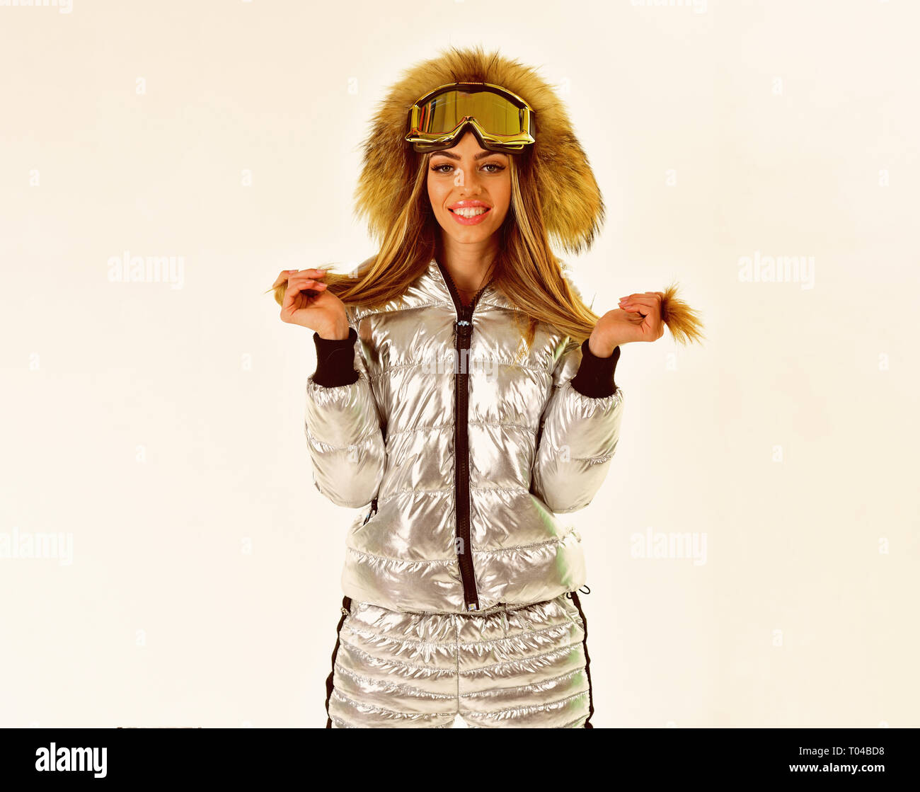 Beaming woman. It is so cold. Happy holidays. Ski resort and snowboarding. Winter sport and activity. Ski boots and glasses. Girl in ski or snowboard - Stock Image