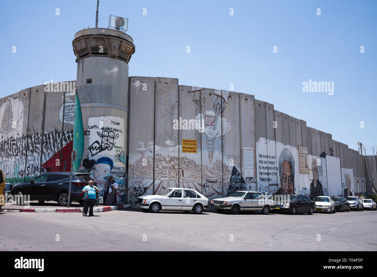 Activist graffiti adorns the Israeli separation wall in the West Bank town of Bethlehem - Stock Image