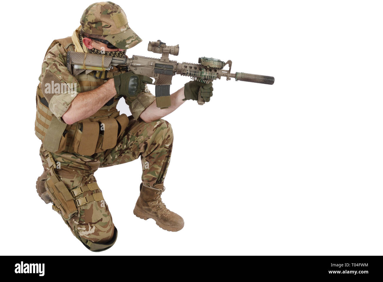 Private Military Company contractor with assault rifle on white background - Stock Image