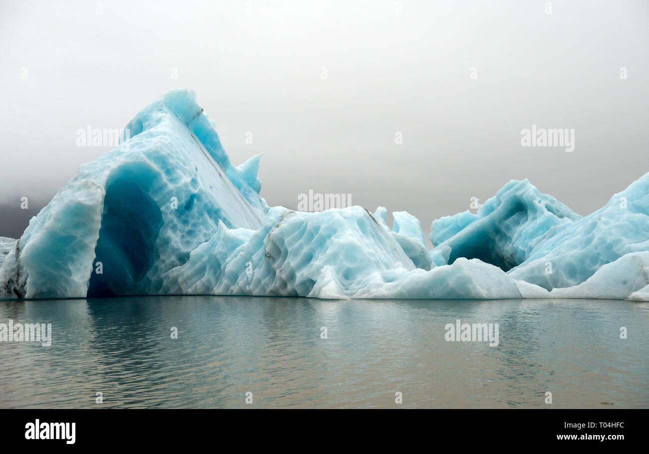Icebergs in Jokulsarlon beautiful glacial lagoon in Iceland. Jokulsarlon is a famous travel destination in Vatnajokull National Park,  Iceland, Stock Photo