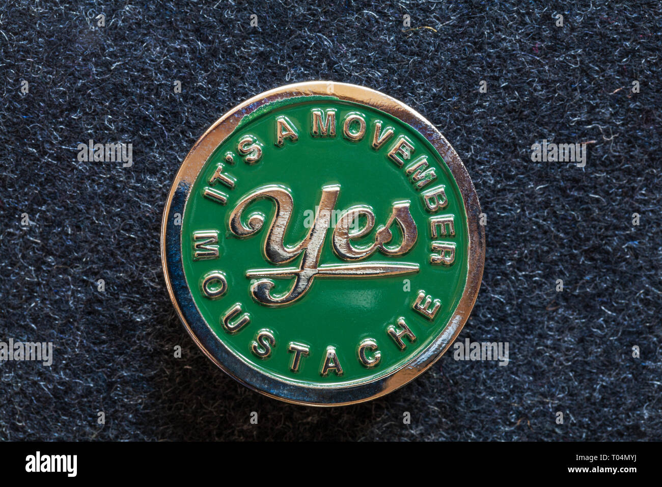 Movember pin badge from Movember Foundation helping men live happier, healthier, longer lives - it's a Movember Moustache yes - Stock Image