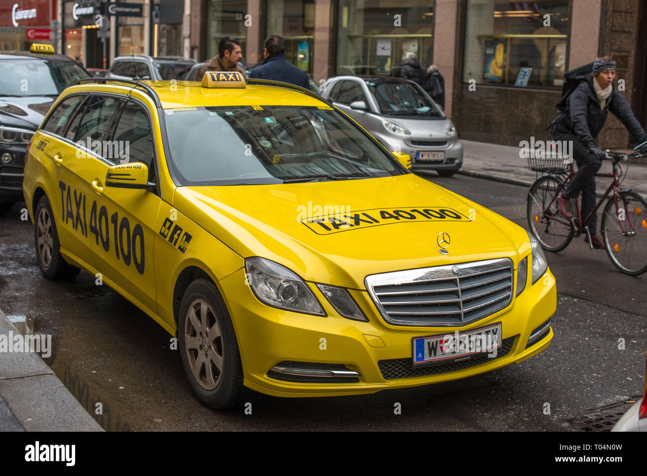 Yellow taxicab in Vienna city centre, Austria. - Stock Image