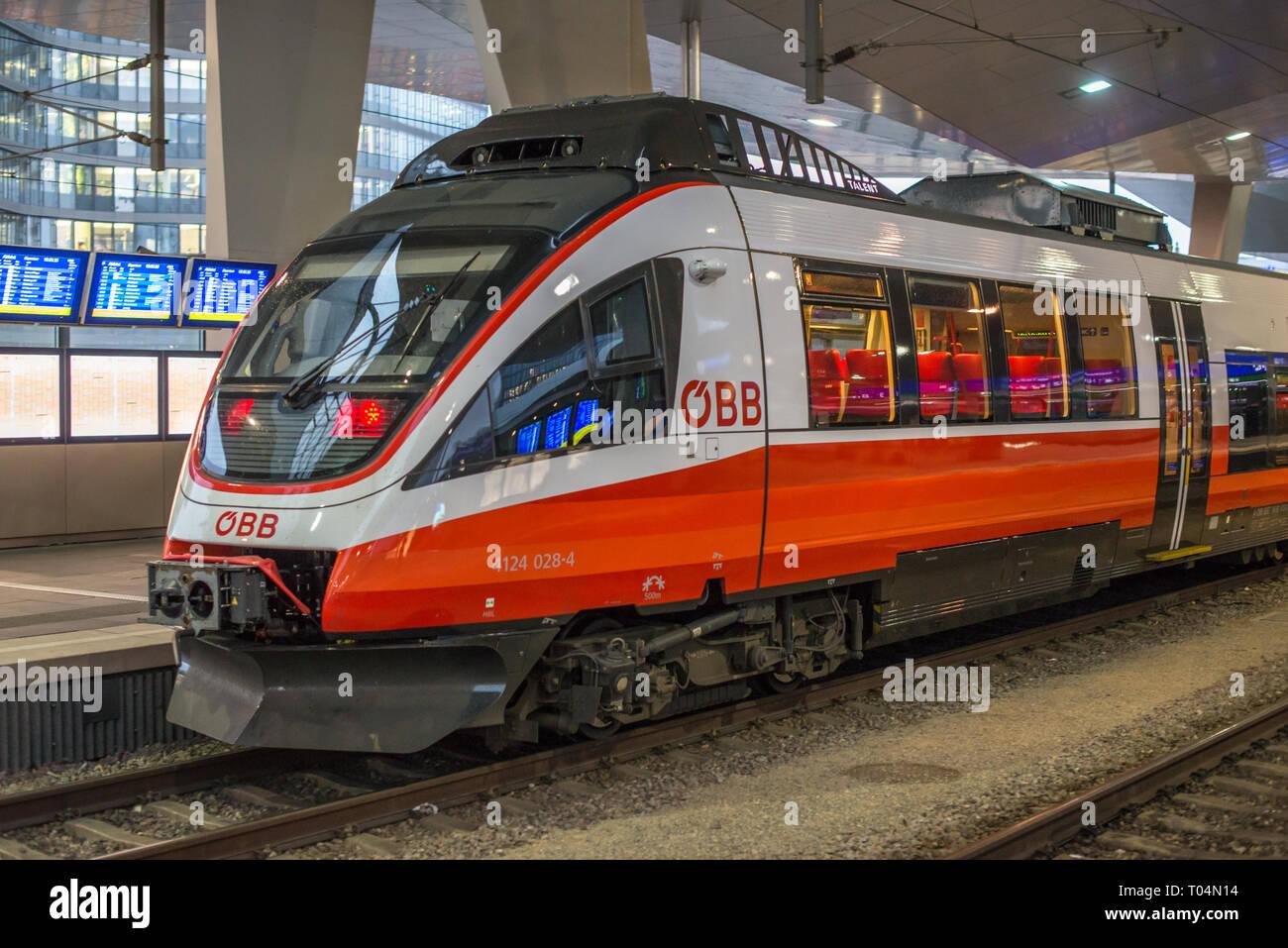 ÖBB Talent railcar approaching platform at Vienna Central station Hauptbanhauf, Austria. - Stock Image