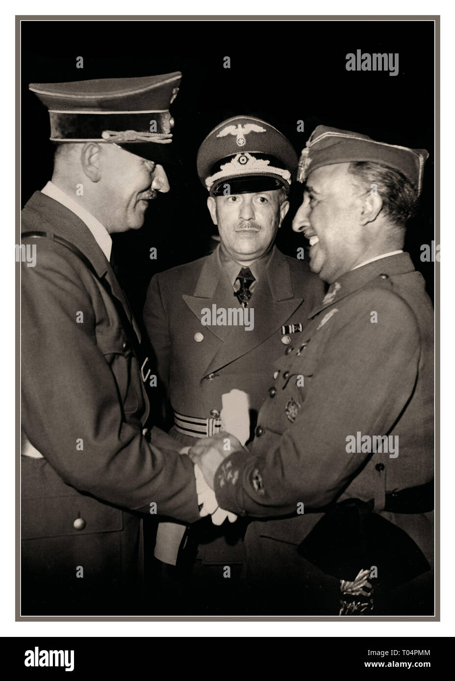 Adolf Hitler and Eberhard von Stohrer greeting General Franco at Hendaye, moments after arriving from his train at around 15:15. 23rd October 1940 Francisco Franco (1892 - 1975) Spanish general and dictator who governed Spain from 1939 to 1975 greeting Adolf Hitler, Nazi German dictator (1889 - 1945). meeting at Hendaye near the Spanish border. - Stock Image