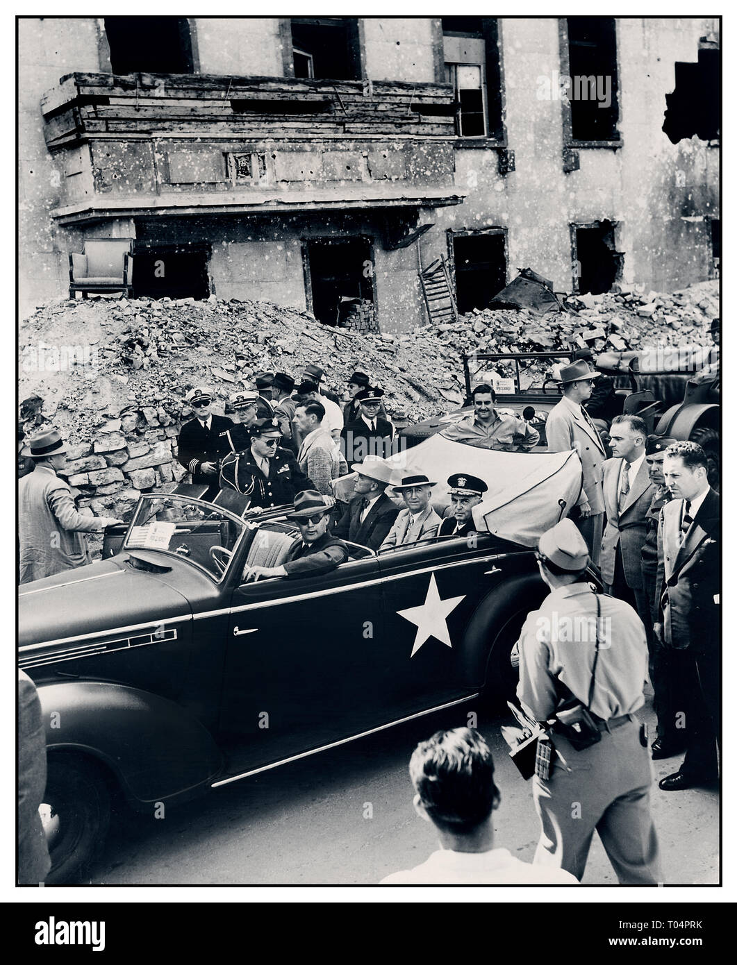 President Truman 1945 Berlin Ruins Post WW2 1945 photograph ( L to R ) in rear seat of car: President Harry S. Truman, Secretary of State James Byrnes, and Fleet Admiral William Leahy inspect the ruins of Hitler's Chancellery in Berlin, Germany. President Truman is in Germany to attend the Potsdam Conference. Stock Photo