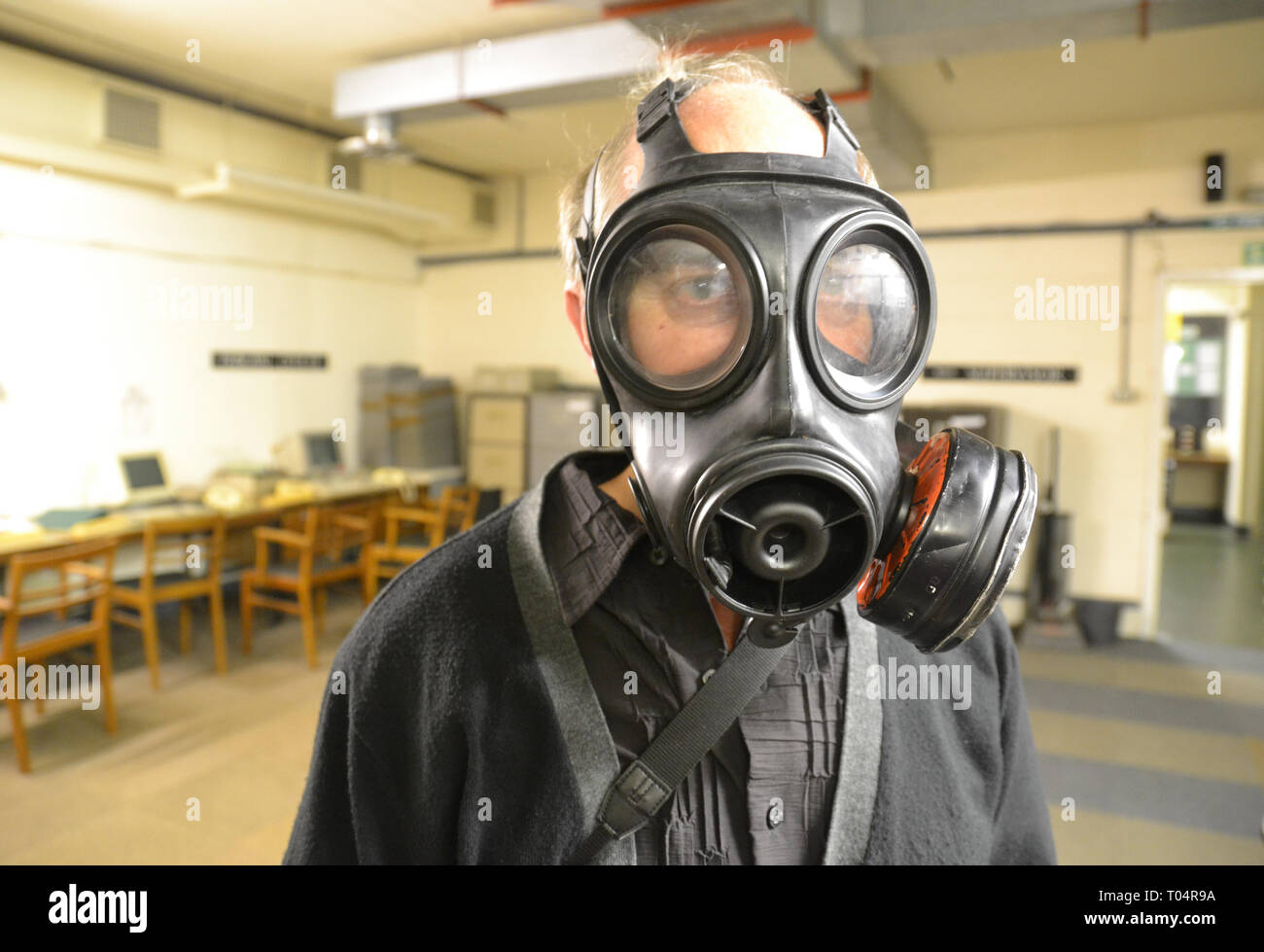 Man in gas mask at the Kelvedon Hatch Secret Nuclear Bunker, Brentwood, Essex, UK - Stock Image