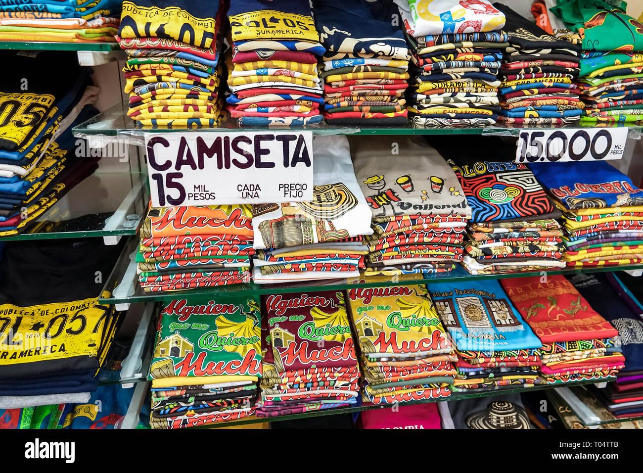 Cartagena Colombia Old Walled City Center centre Centro shopping display sale tee shirts souvenirs Playa de las Bovedas sign price pesos - Stock Image