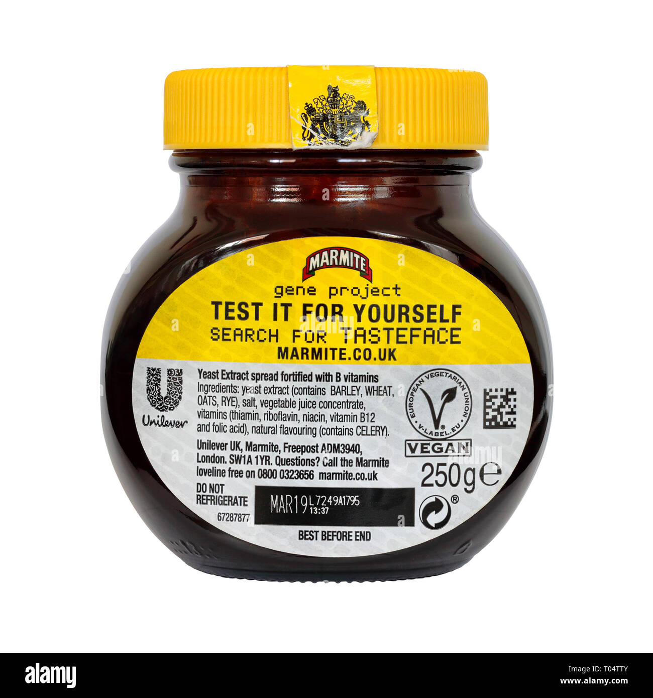 Rear View of a 250g Jar of Marmite gene project edition isolated on a white background with best before date and Unilever logo and vegan logo Stock Photo