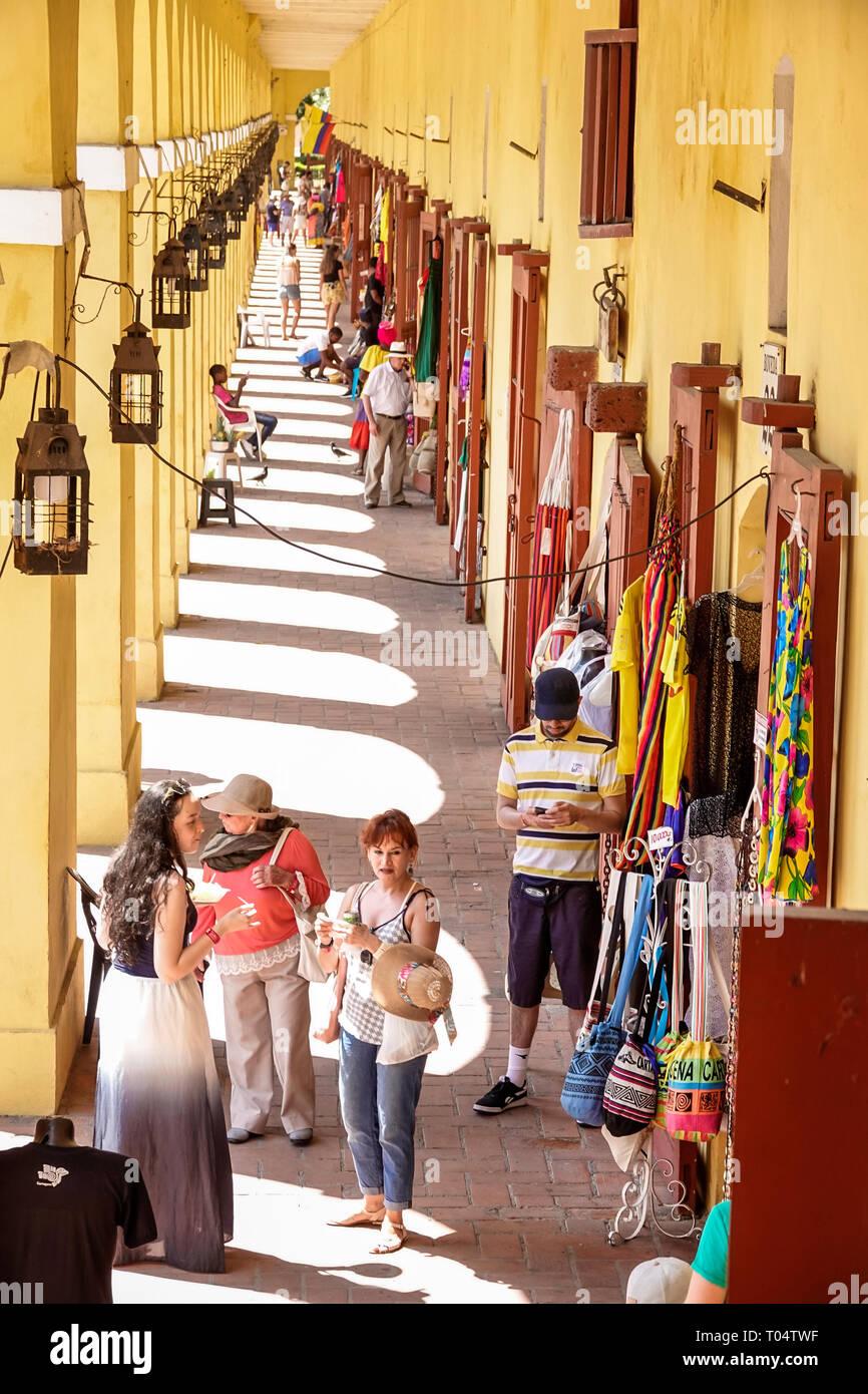 Cartagena Colombia Old Walled City Center centre Centro Playa de las Bovedas shopping plaza corridor overhead view lanterns vendors man woman - Stock Image