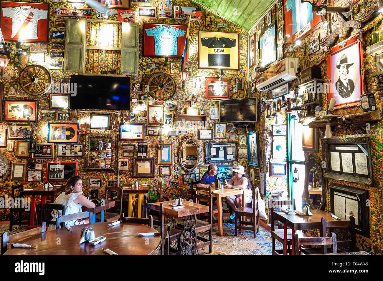 Cartagena Colombia Old Walled City Center centre Centro Marzola Parrilla Argentina restaurant inside unusual eccentric decor tables man woman dining - Stock Image