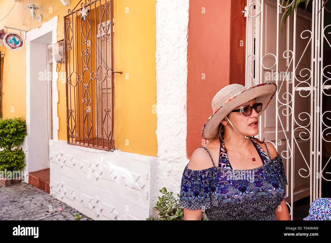 Cartagena Colombia Old Walled City Center centre Centro Hispanic resident residents woman decorative wrought iron window bars - Stock Image