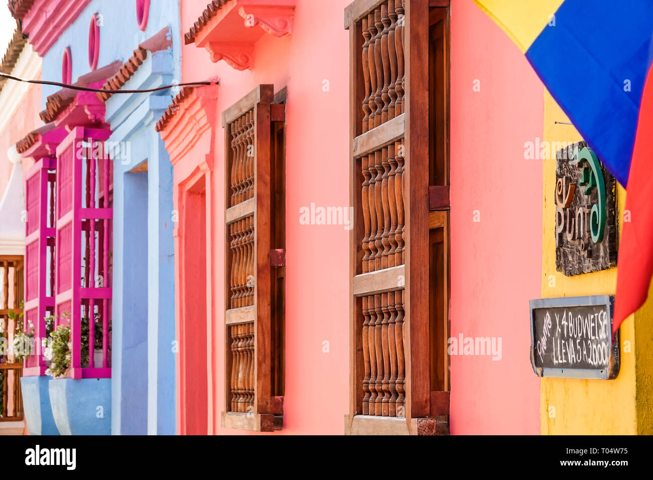 Colombia, Cartagena, Old Walled City Center centre, San Diego, colorful, buildings, colonial wood spindle window bars, sightseeing visitors travel tra Stock Photo
