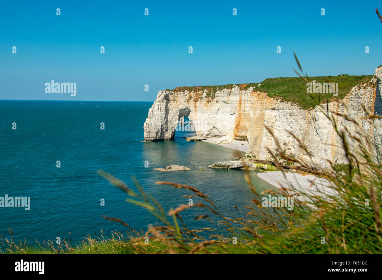 etretat white cliffs in france normadie and suny day - Stock Image