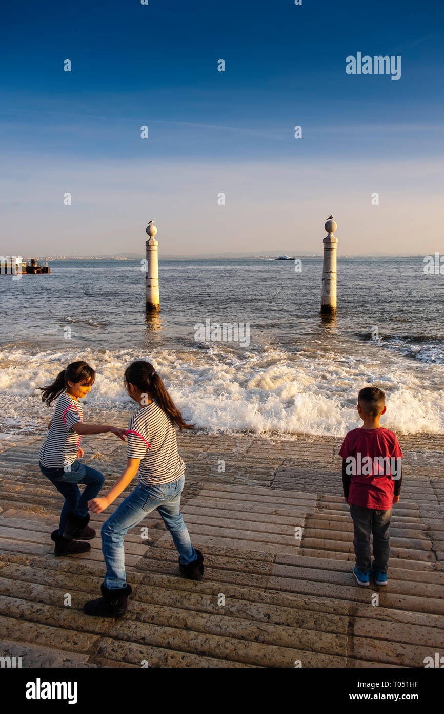 People having fun with water at columns Pier, Commerce Square. Lisbon, Portugal. Europe - Stock Image