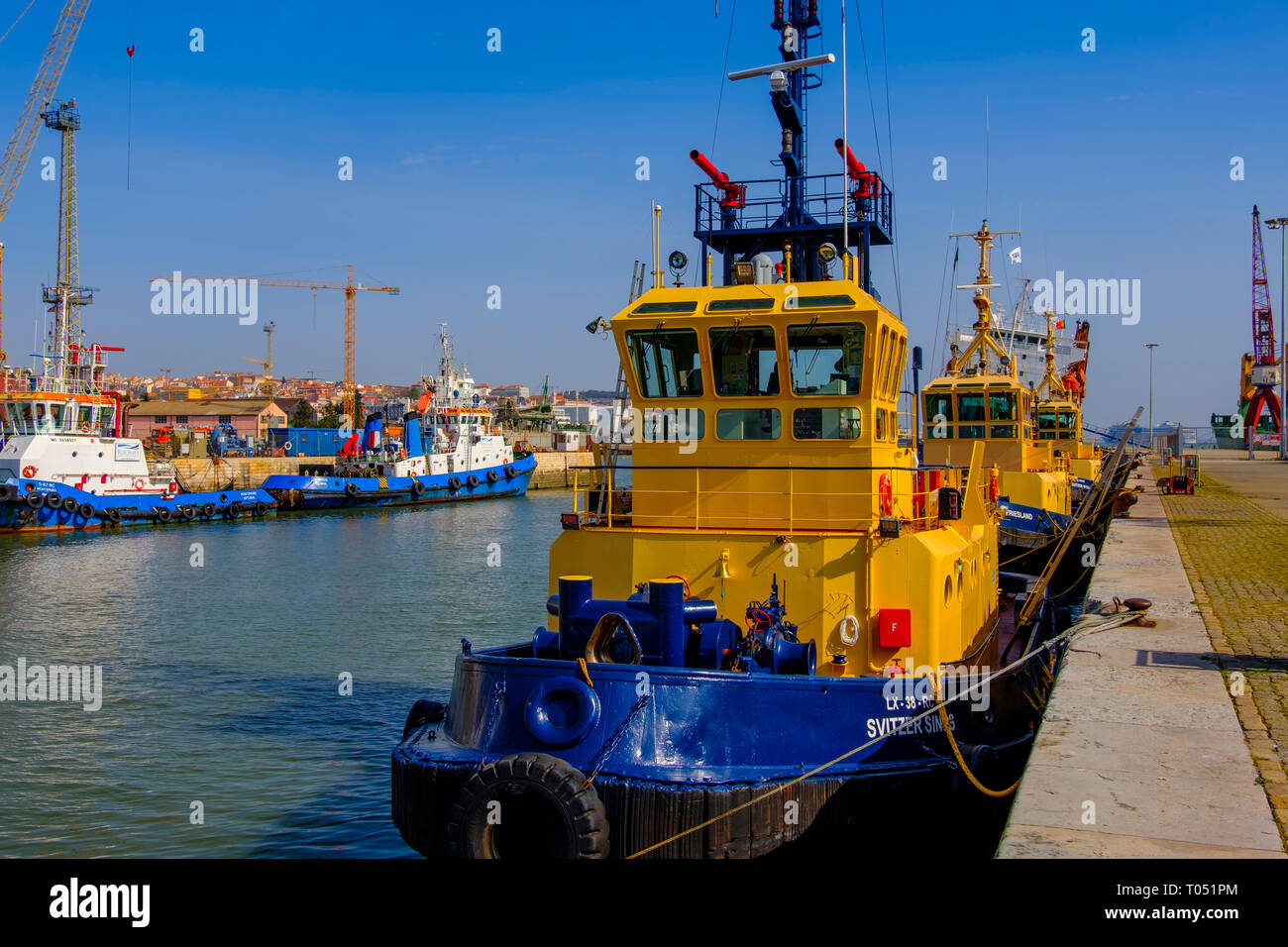Tugboat in the harbor. Comercial port, Lisbon, Portugal. Europe - Stock Image