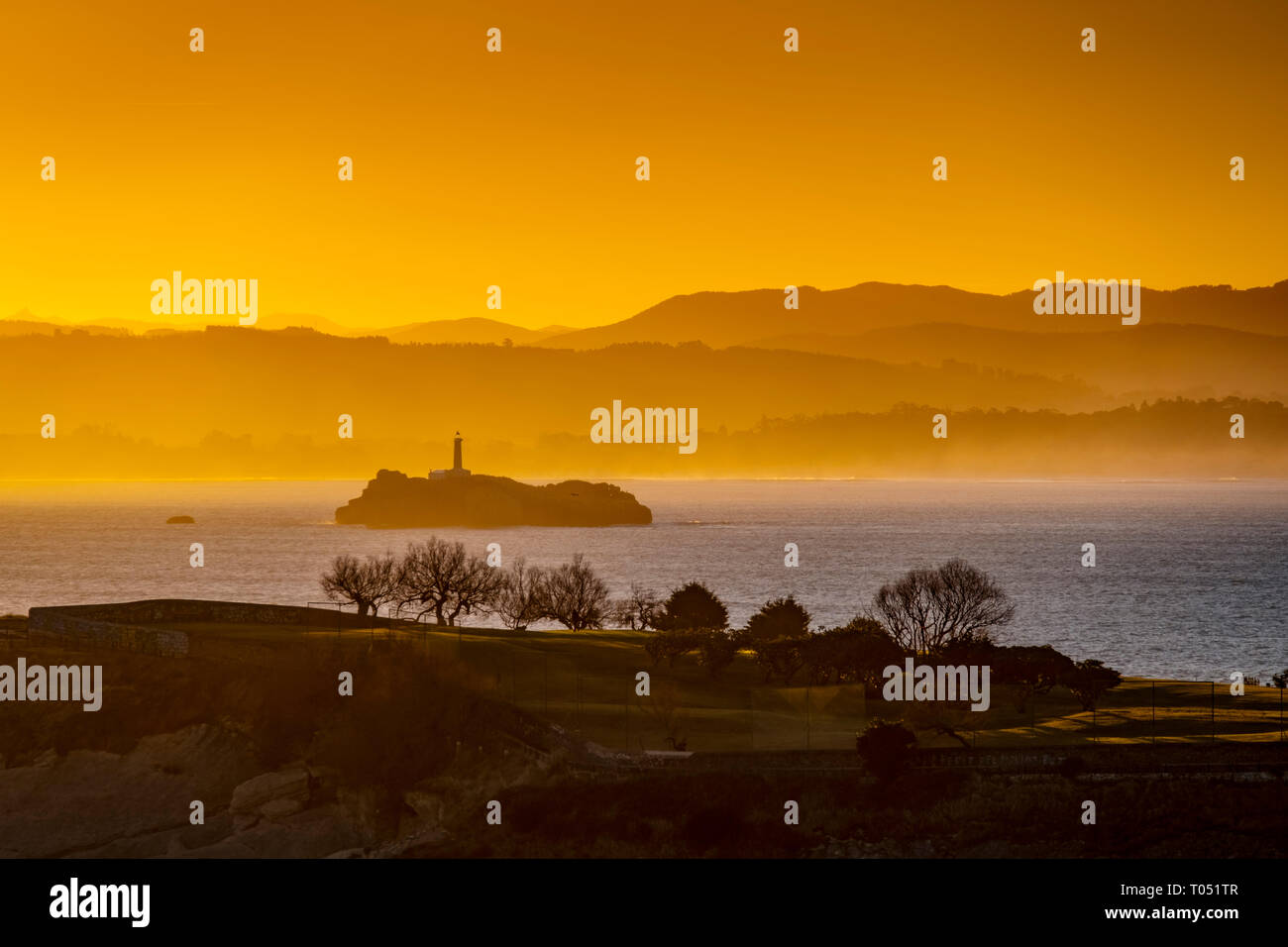 Panoramic view at sunrise. Viewpoint Lighthouse of Cabo Mayor. Santander coast and Cantabrian Sea. Cantabria, Spain. Europe Stock Photo