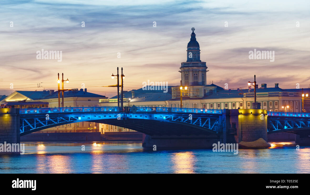 St. Petersburg, Russia - March 18, 2015: Night view to Neva river, Palace bridge and the Kunstkamera building. Built in 1727, Kunstkamera was the firs - Stock Image