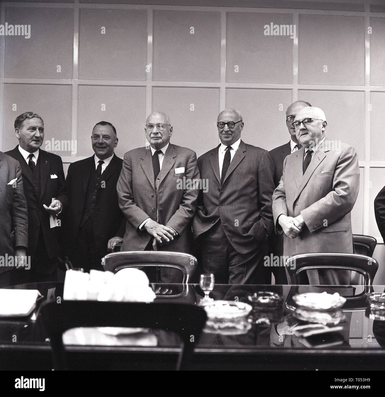 1964, Football club directors in the boadroom, England, UK. In era clubs were owned by football loving businessmen from the local community who had sone well and wanted to put something back into the game. Stock Photo