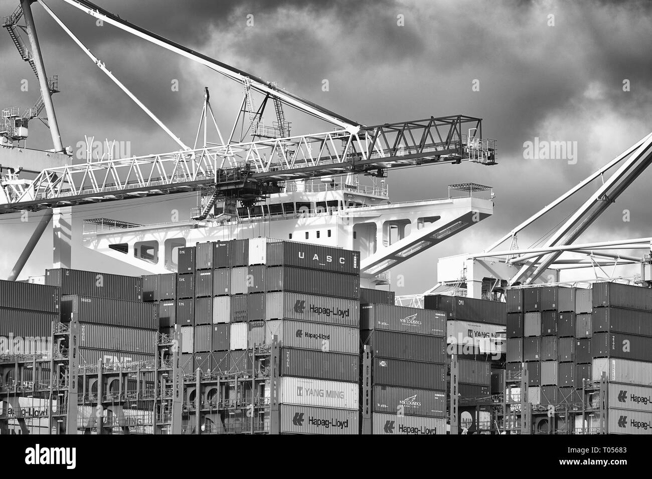 Black & White Image Of The Ultra-Large, 400 Metre, UASC Container Ship, BARZAN, Loading And Unloading In The Southampton Container Terminal, UK. - Stock Image