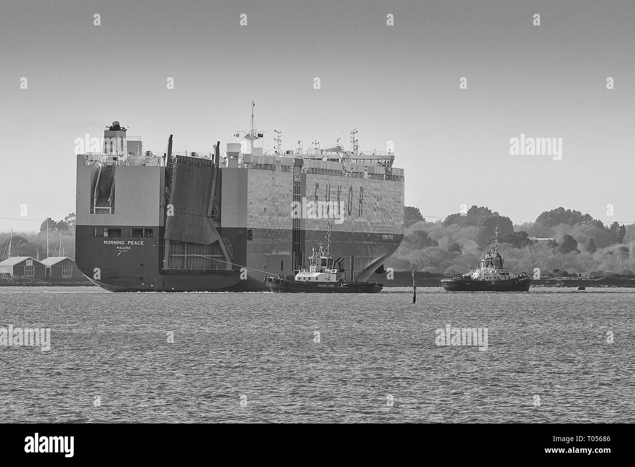 Black & White Image Of The EUKOR Car Carrier Ship, MORNING PEACE, Enters The Port Of Southampton, UK. - Stock Image
