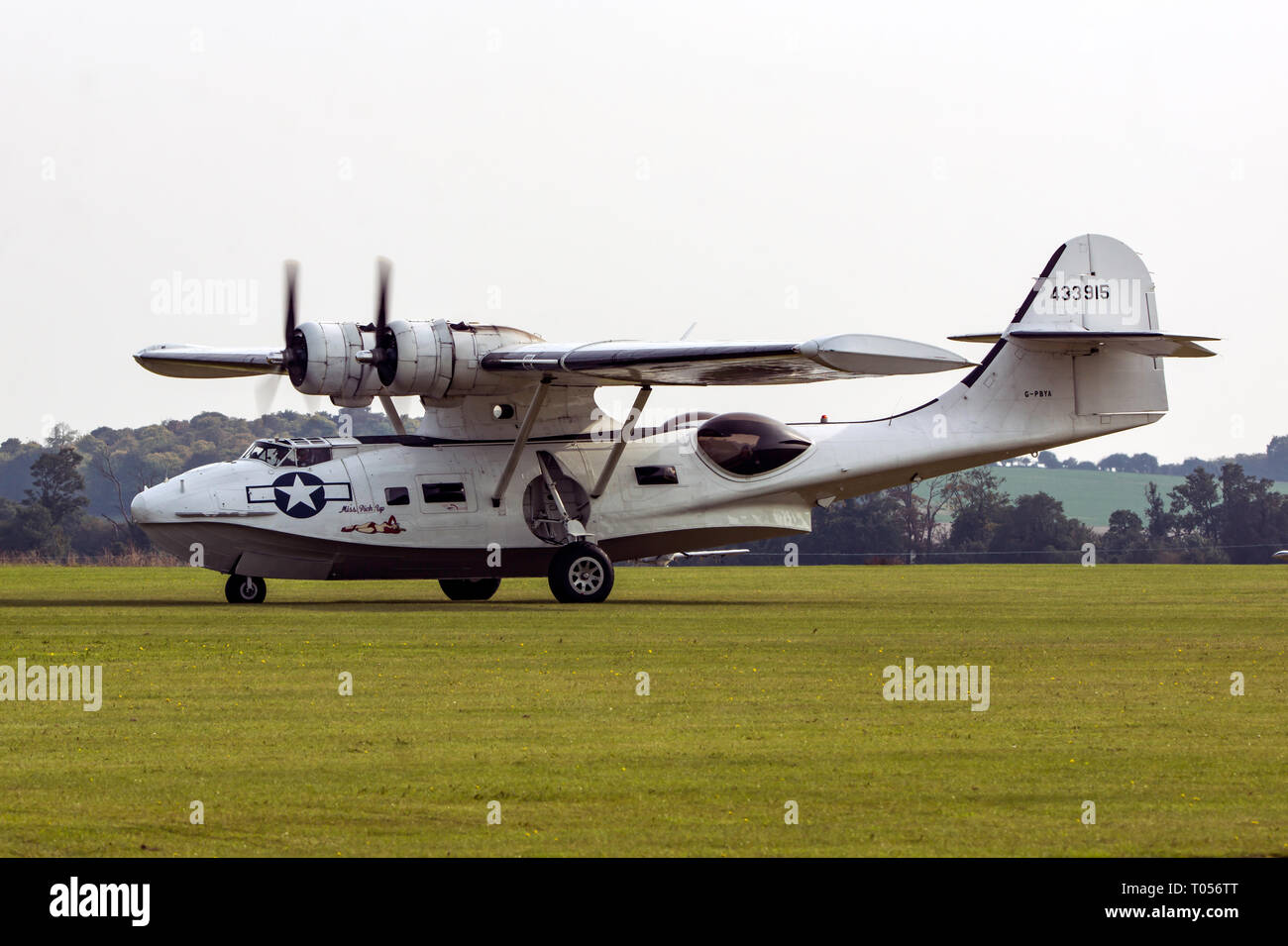A Consolidated PBY-5A landing at Duxford airfield - Stock Image
