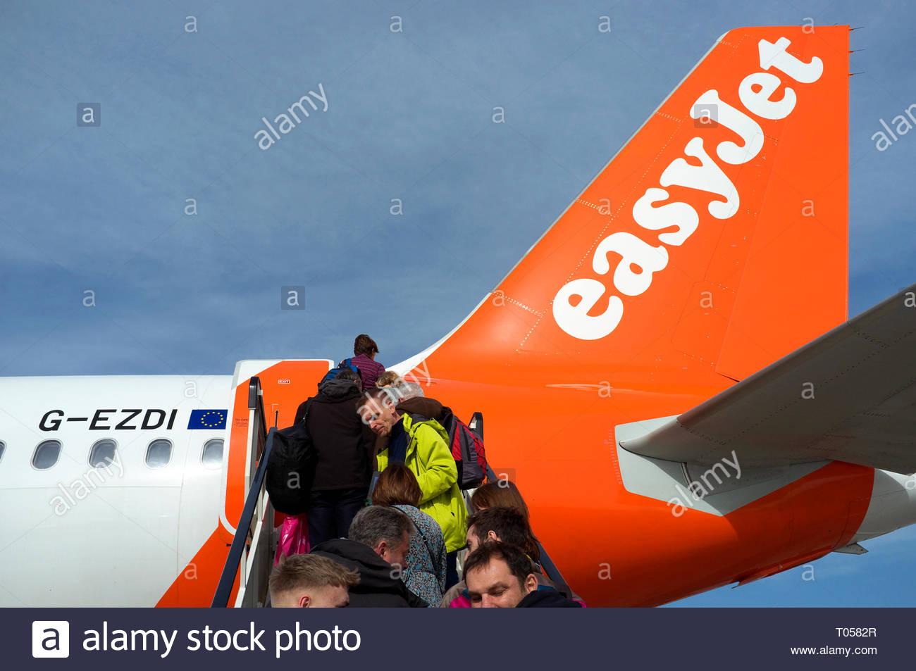 Passengers ascend the steps to board an Easyjet flight at Bristol Airport, Lulsgate, Bristol, UK. Stock Photo