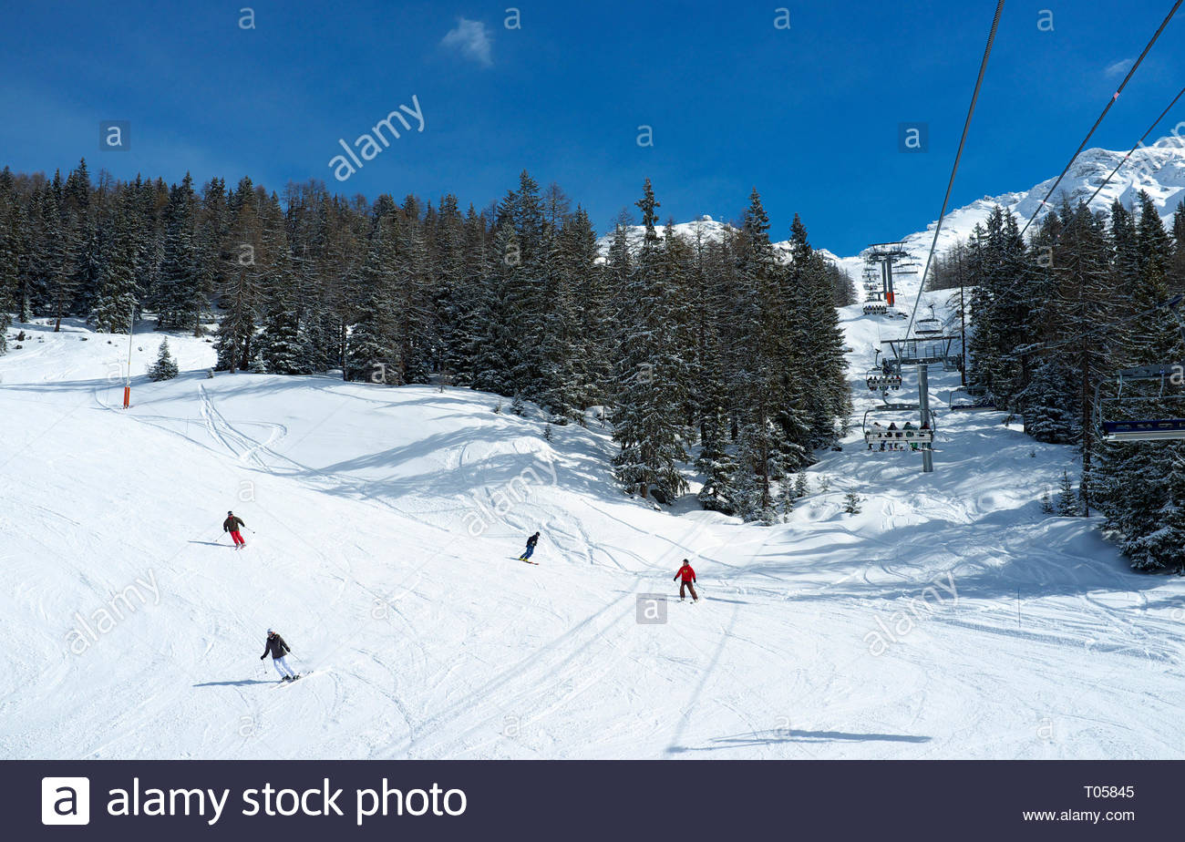 Skiers make their way down hill at the ski resort in Sainte-Foy-Tarentaise, Auvergne-Rhône-Alpes region in south-eastern France. Stock Photo