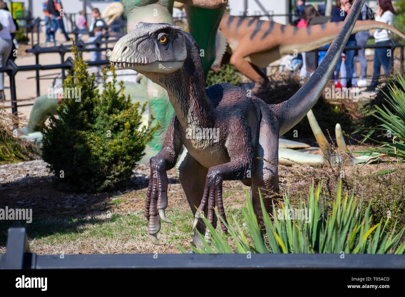 People visit the dino park Dinosville in Svilajnac, Serbia. - Stock Image
