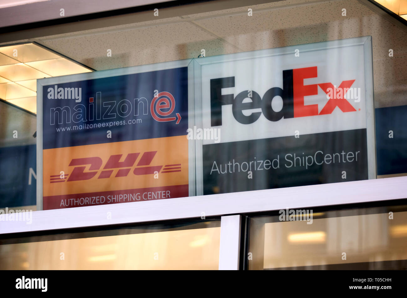 Signage above a branch of a shipping center in Center City Philadelphia, PA on March 15, 2019. - Stock Image