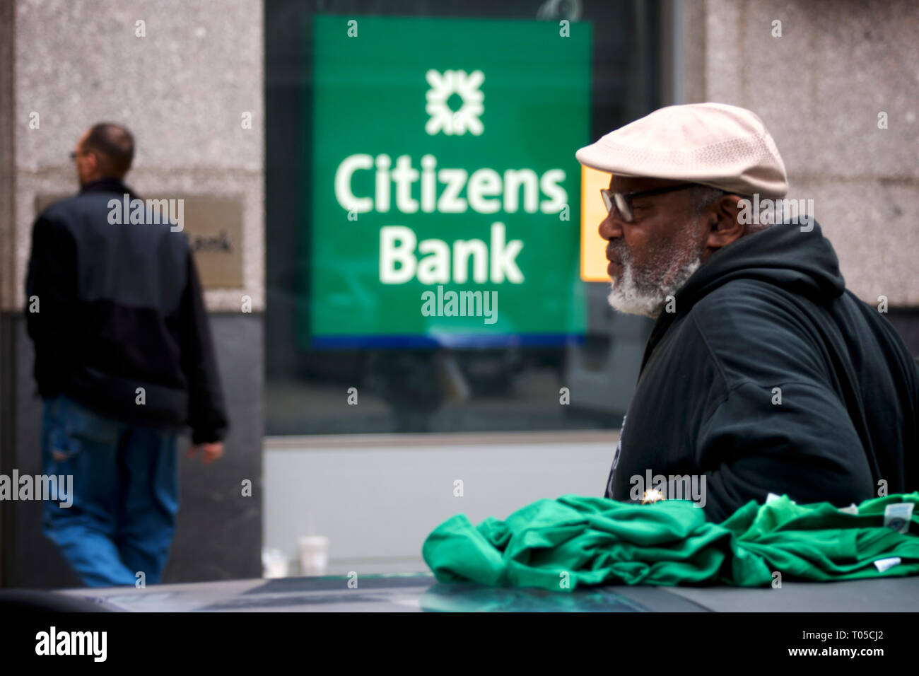 People walk past a branch of Citizens Band in Center City Philadelphia, PA on March 15, 2019. - Stock Image