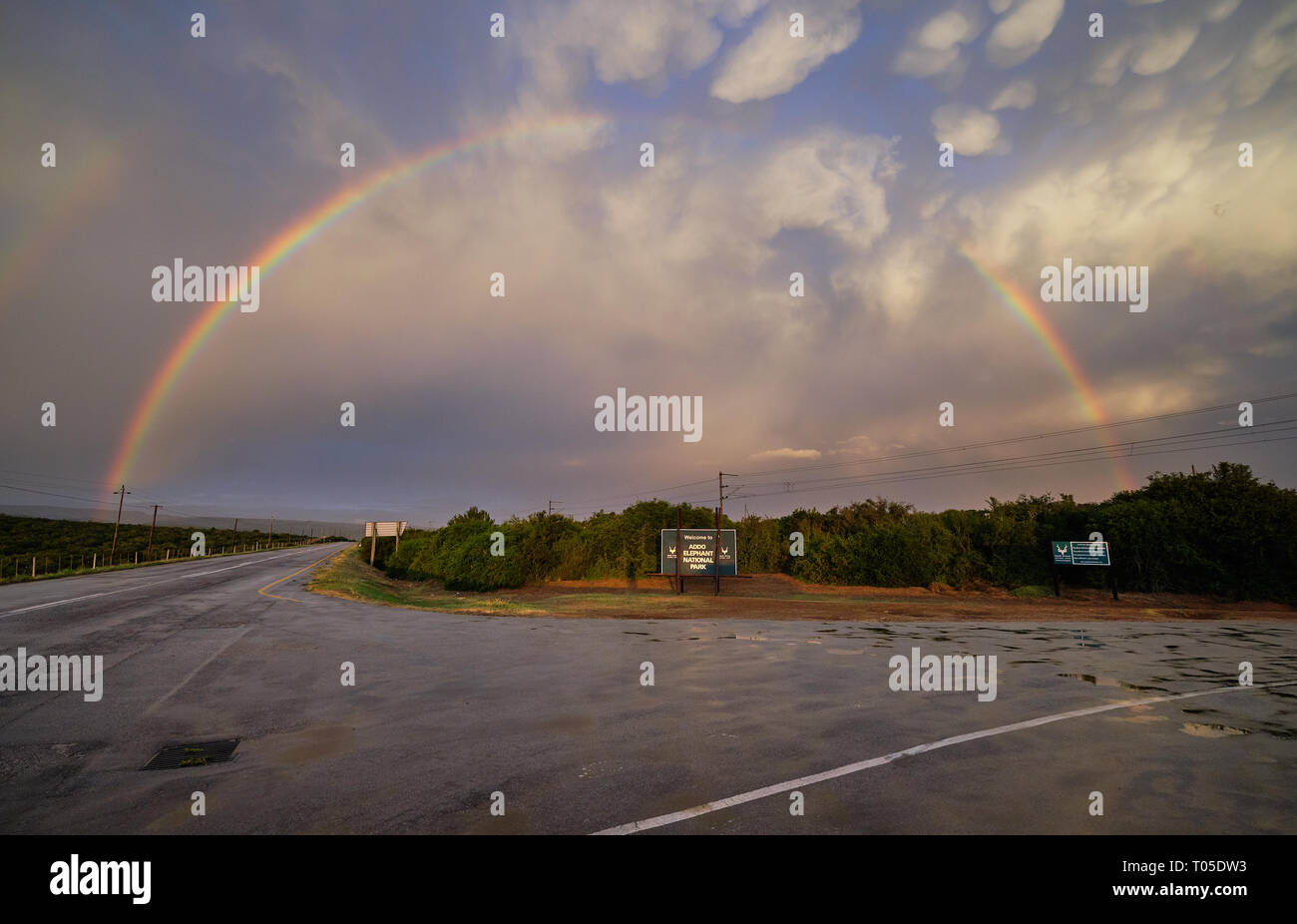 Full rainbow over the entrance sign to the Addo National Park in South Africa Stock Photo