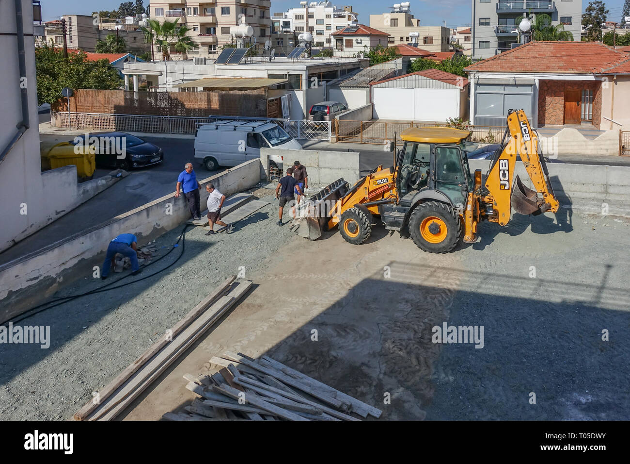 Limassol, Cyprus - November 4, 2018: JCB with workmen on abuilding site. Stock Photo