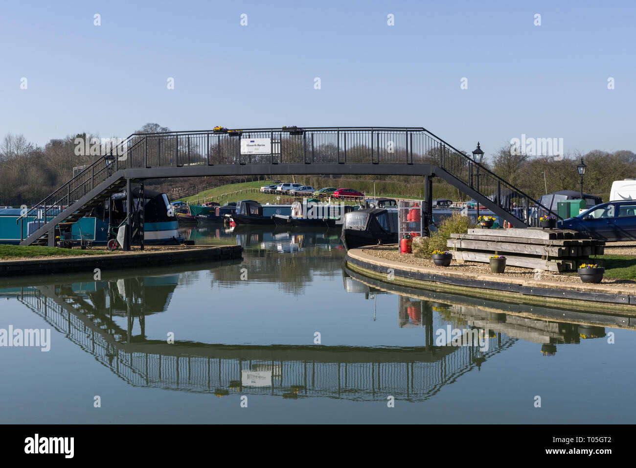 Entrance from the Grand Union canal under a pedestrian bridge to Blisworth Marina, Northamptonshire, UK - Stock Image