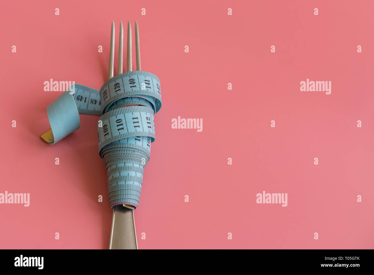 Fork Wrapped In Tape Measure On Pink Background Proper Nutrition Medical Starvation Diet For Weight Loss Concept Free Space For Text Stock Photo 241068147 Alamy