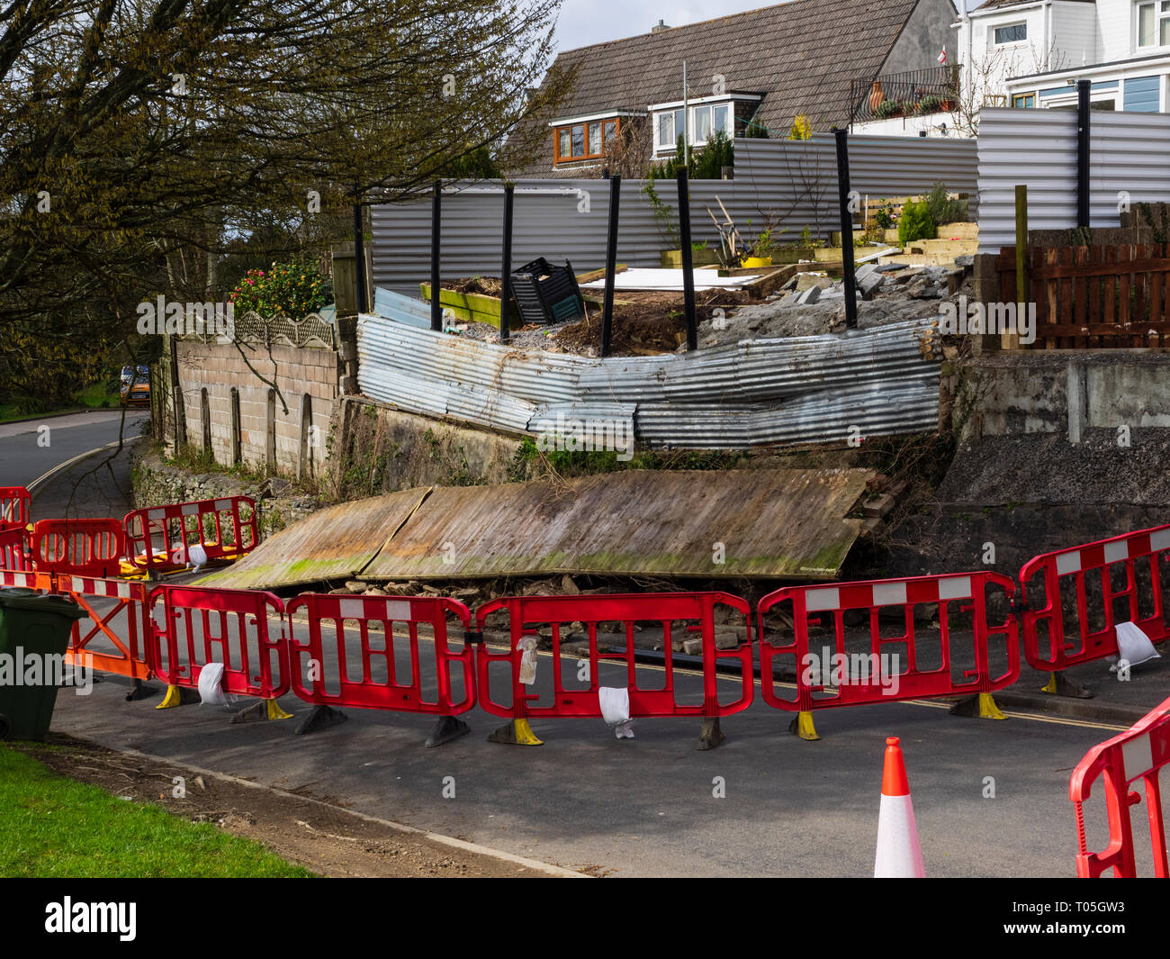 Wall collapse and road closure following March 2019 storm Gareth in a Plymouth street - Stock Image