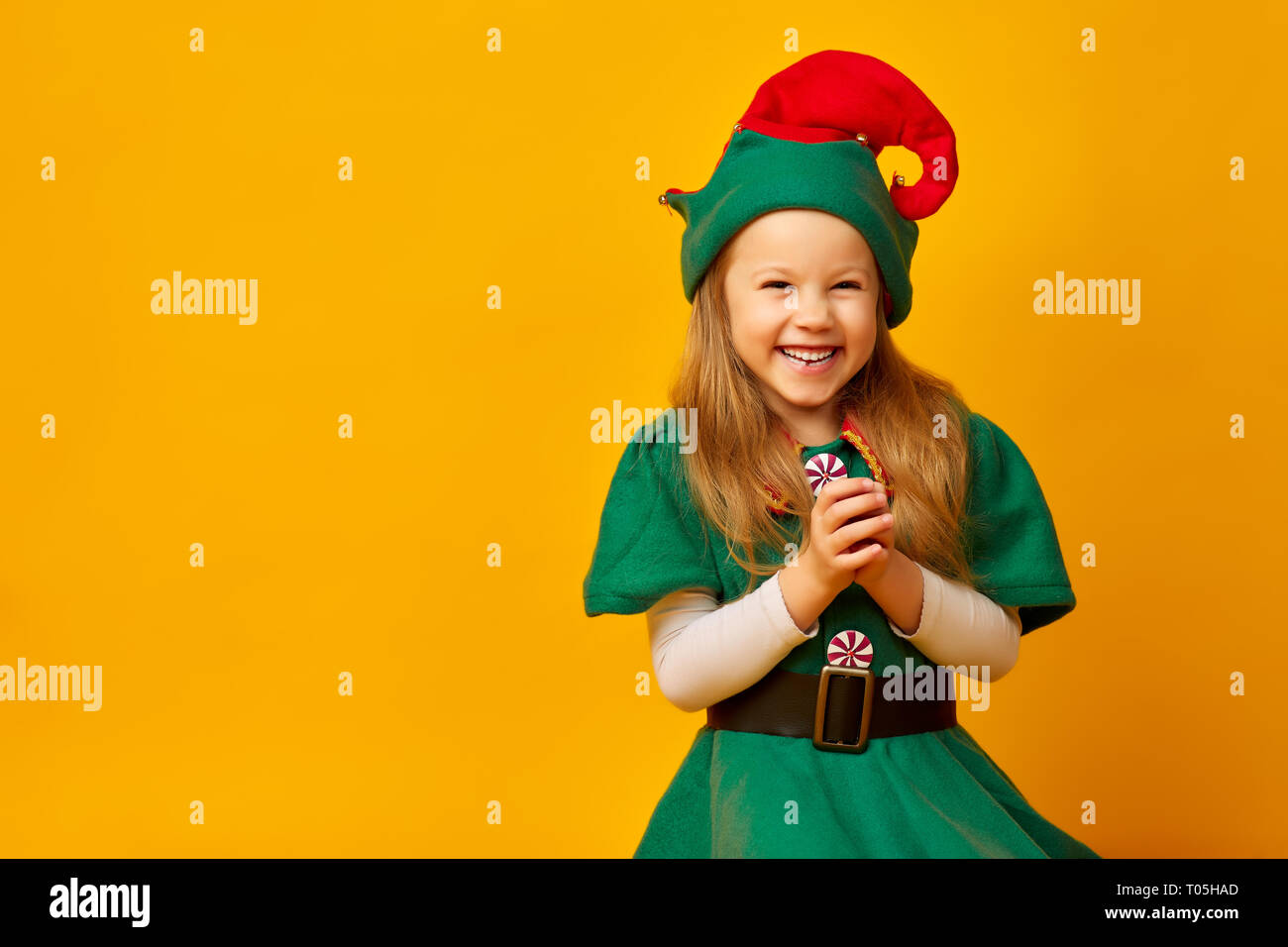cunning little girl elf, studio photo on a background - Stock Image