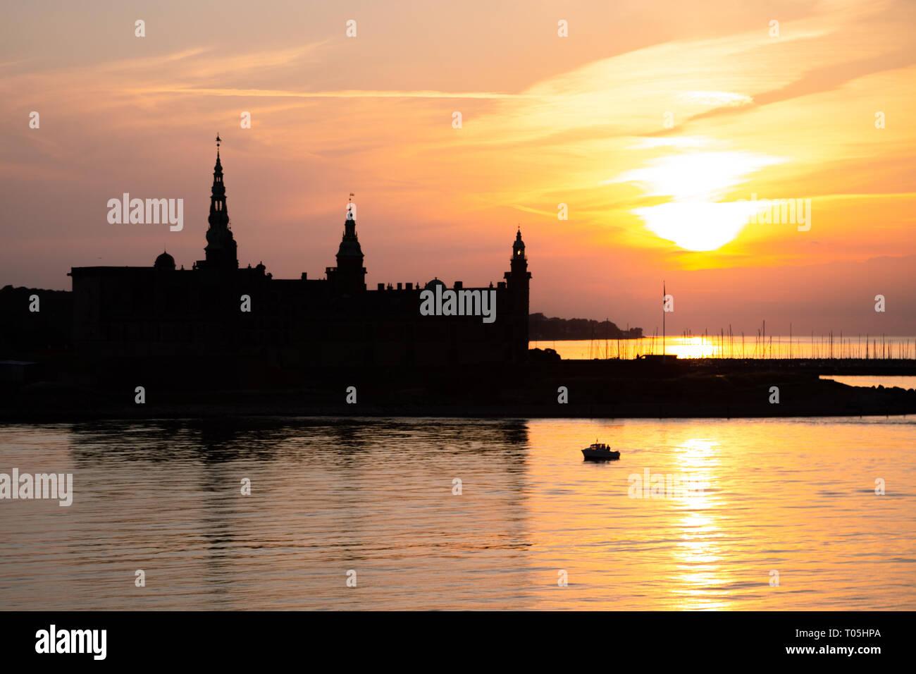 Kronborg castle silhouette in Helsingor at sunset - Stock Image