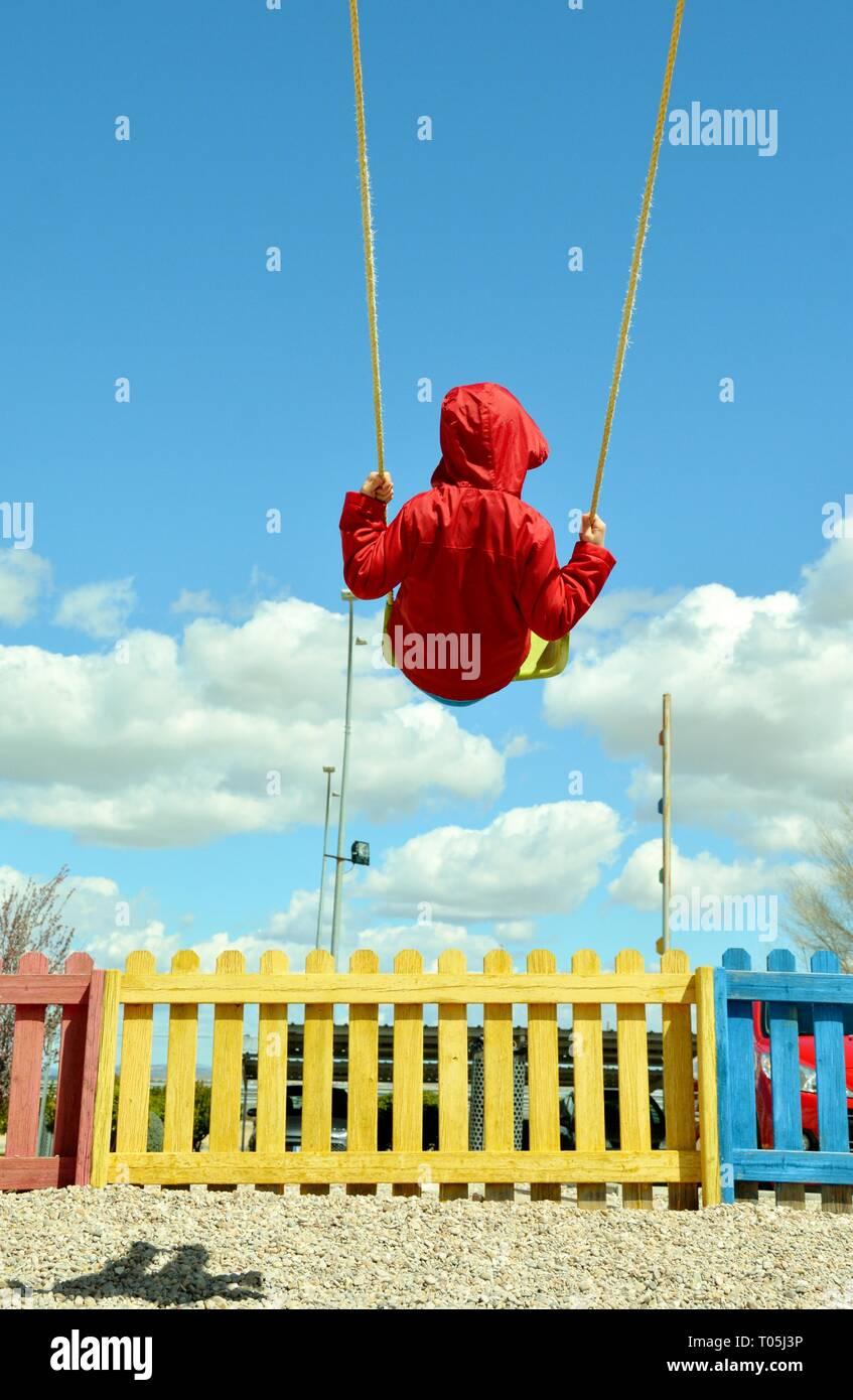 child swinging - Stock Image