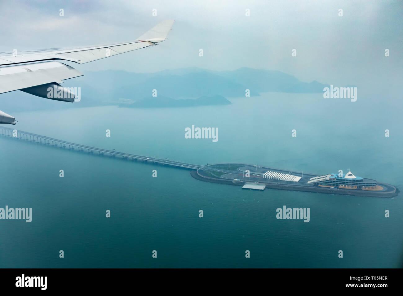 aerial view from plane window of hong kong - juhai - macau bridge crossing ocean harbor Stock Photo