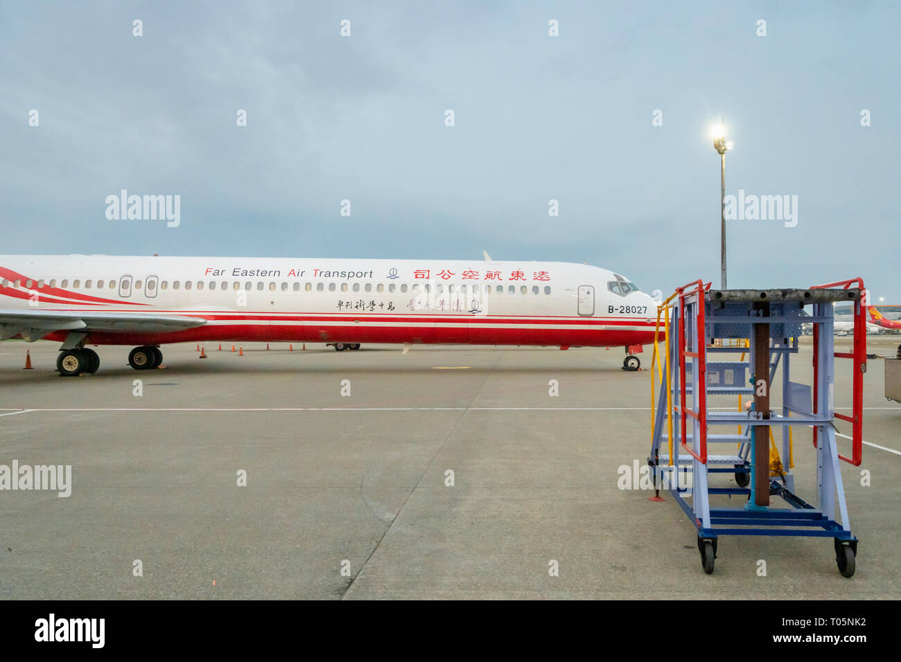 Taipei, Taiwan - March 2019:  Far Eastern Air Transport aircraft on runway of Taipei Taoyuan Airport. Far Eastern Air Transport is a regional airline - Stock Image