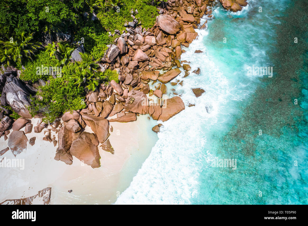 Aerial drone photo of Seychelles tropical beach Anse Marron at La Digue island - Stock Image