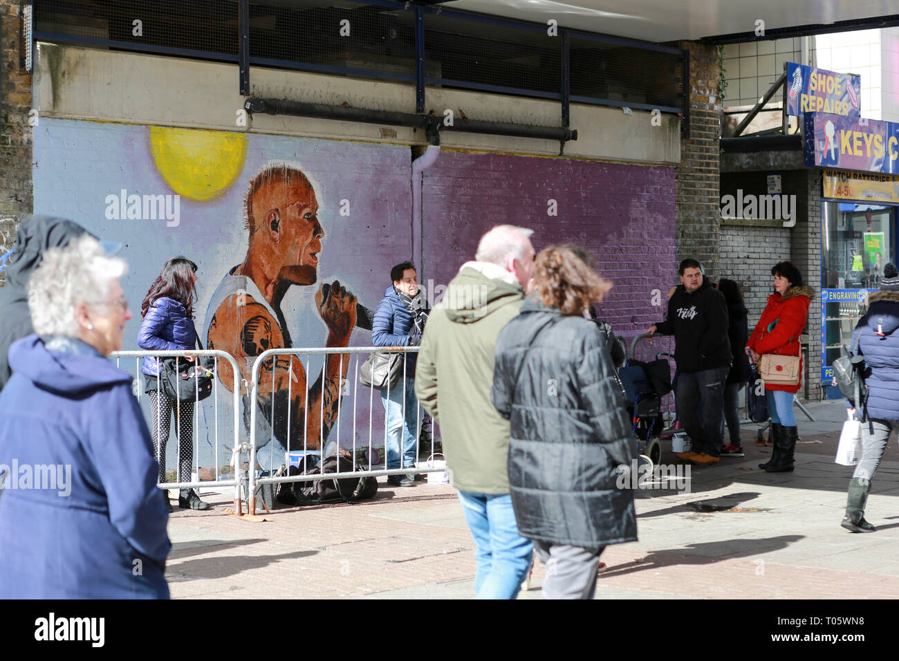 Southend on Sea, UK. 17th March, 2019. Sunday morning shoppers pass by as Local artist John Bulley works on his latest art work, a picture of the late Keith Flint from the band The Prodigy. Images taken with permission from the artist John Bulley. Penelope Barritt/Alamy Live News - Stock Image