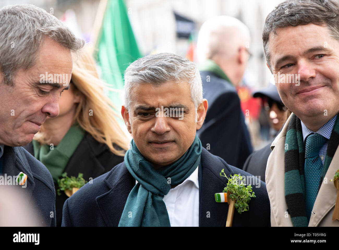 London, UK, 17 March 2019  The London St Patrick's Day Festival, now in its 17th year, attracts more than 125,000 people to events across London and to the parade and festival in central London and Trafalgar Square. This year's theme is #LondonIsOpen. Leading the parade were London Mayor Sadiq Khan and actor James Nesbitt, and Irish Finance Minister Paschal Luke Donohoe.  Credit: Ilyas Ayub/ Alamy Live News - Stock Image