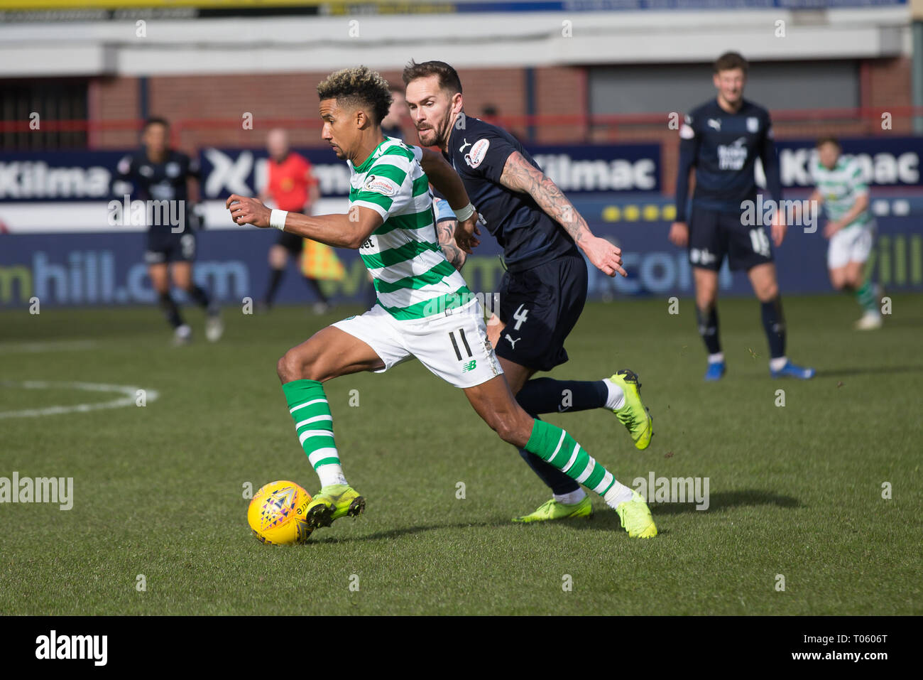 Dundee, UK. 17th Mar, 2019. Ladbrokes Premiership football, Dundee versus Celtic; Scott Sinclair of Celtic goes past Martin Woods of Dundee Credit: Action Plus Sports/Alamy Live News - Stock Image