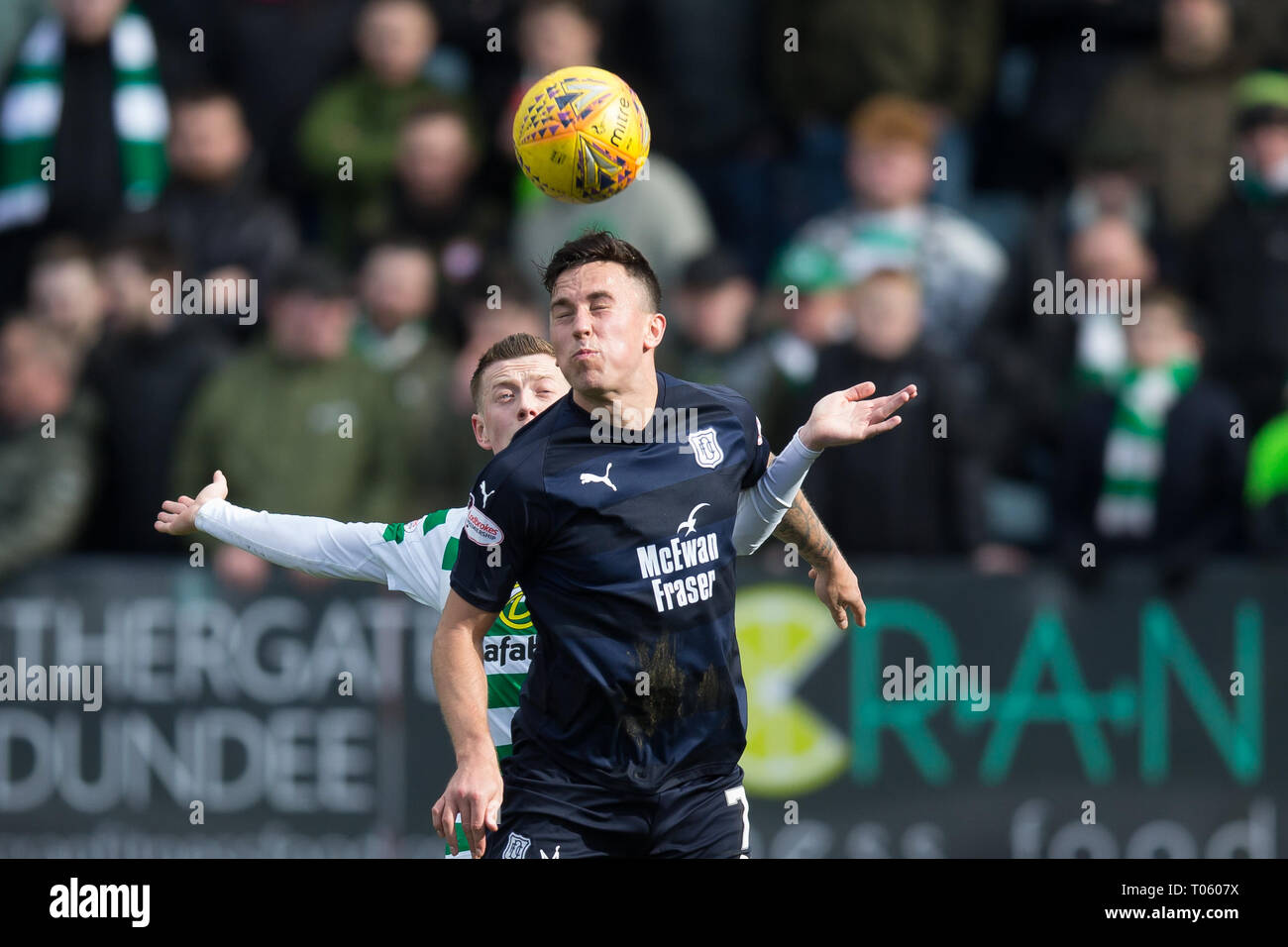 Dundee, UK. 17th Mar, 2019. Ladbrokes Premiership football, Dundee versus Celtic; John O'Sullivan of Dundee competes in the air with Callum McGregor of Celtic Credit: Action Plus Sports/Alamy Live News - Stock Image