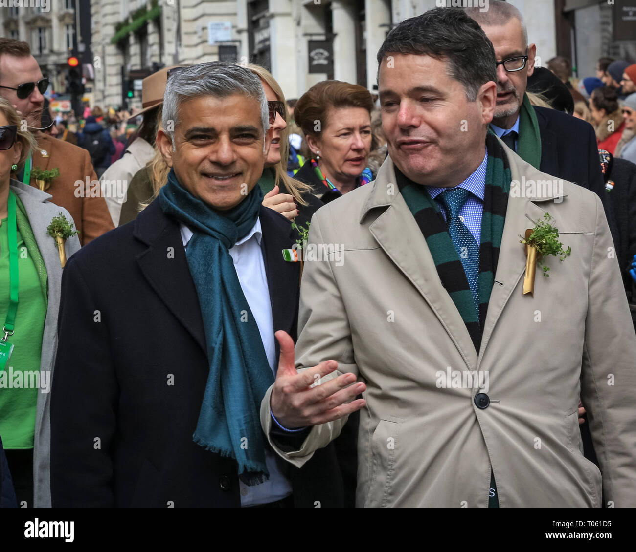 London, UK, 17th Mar 2019. Sadiq Khan (m), with Irish Minister of Finance Paschal Donoghue (r) and James Nesbitt (l). Now in its 17th year, the parade attracts more than 50,000 people for a colourful procession of Irish marching bands from the UK, US and Ireland, energetic dance troupes and spectacular pageantry. Credit: Imageplotter/Alamy Live News - Stock Image